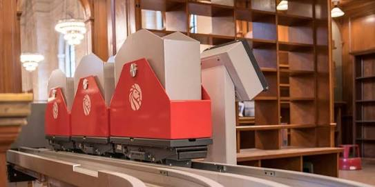 Train to deliver books inside library